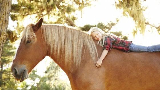 Bambini stimolati nelle loro emozioni dal rapporto con i cavalli