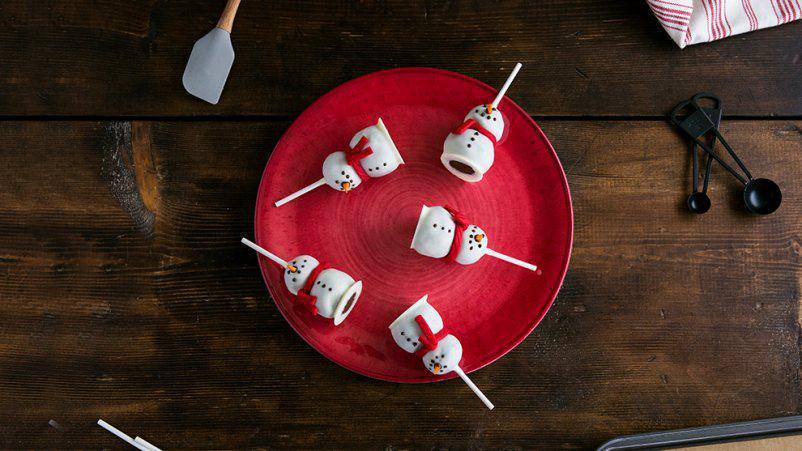Cake Pops di zucca a forma di pupazzo di neve