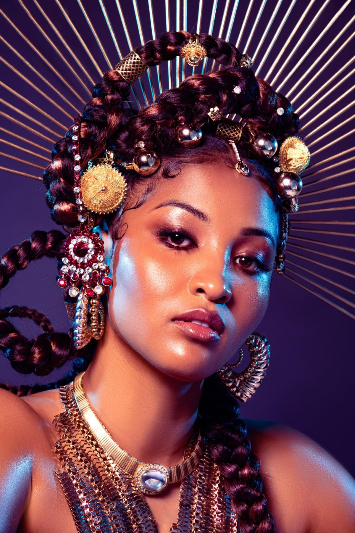 Shenseea; the only female rapper featured on DONDA