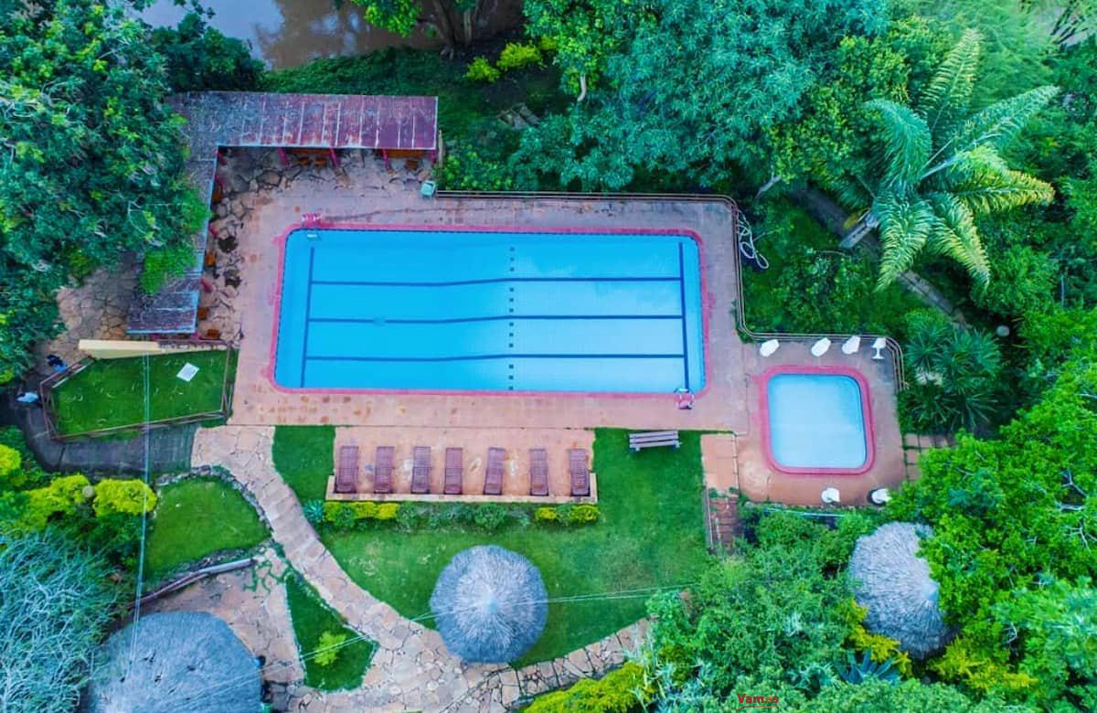 Stay in this Vintage Villa with a pool and park views from 2649 Per Person!