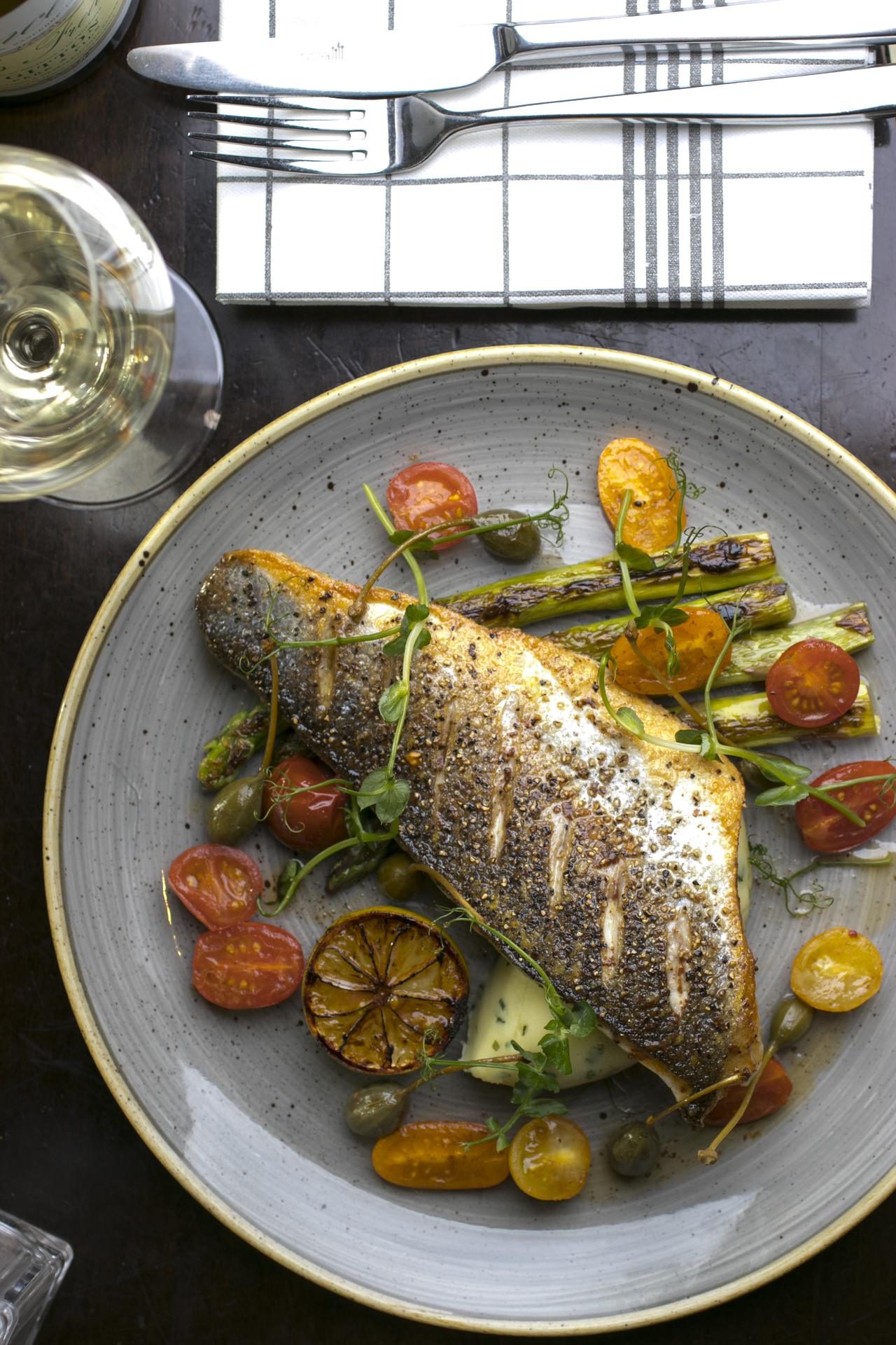 Pan-fried Fillet of Hake, grilled asparagus, heirloom cherry tomato and capers dressing