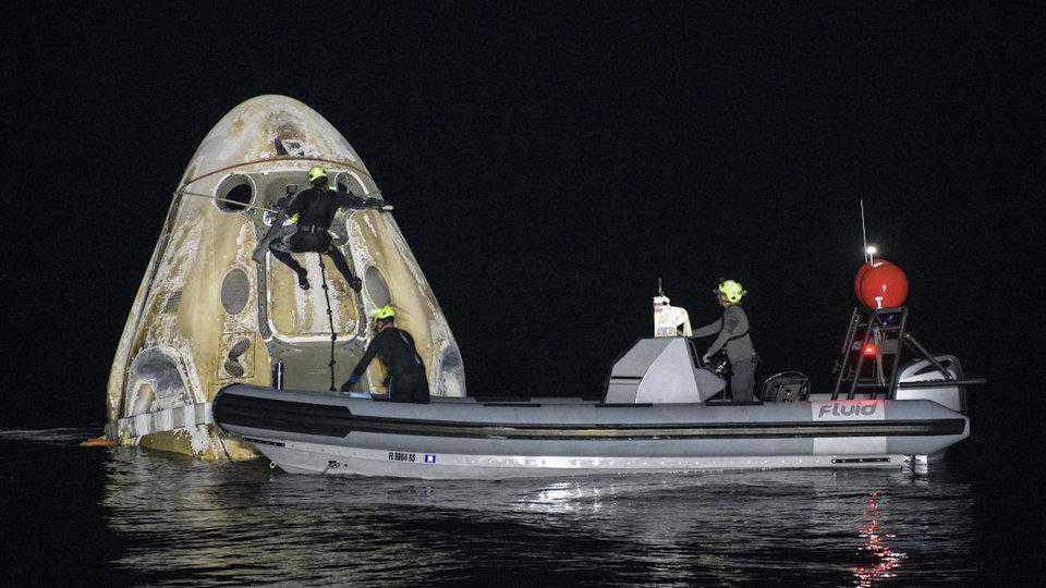 Astronauts safely splash down after Space Station mission