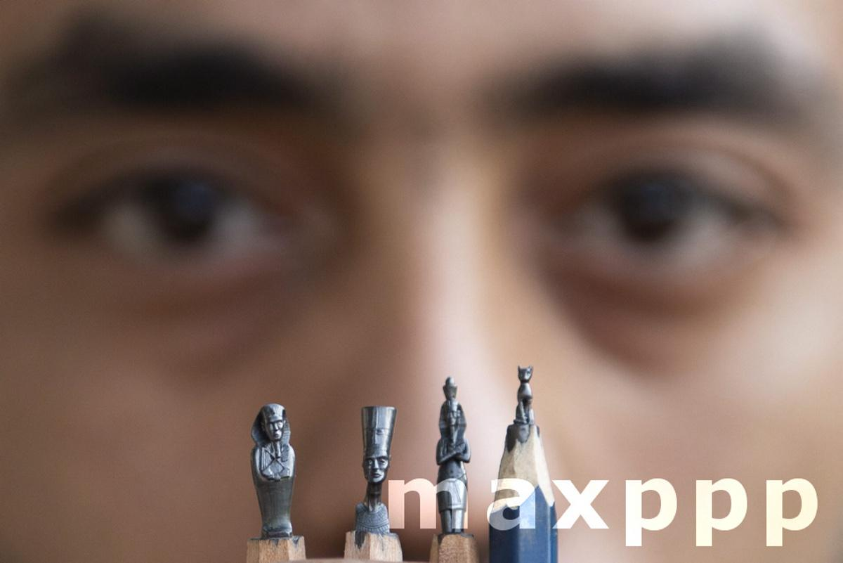 Egyptian fine artist carves pharaonic icons on pencils.