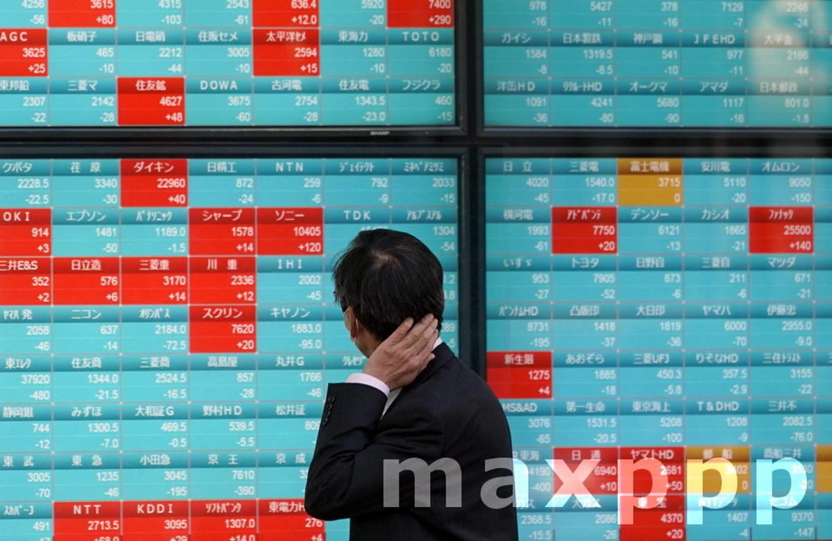Tokyo stocks lower on possible state of emergency