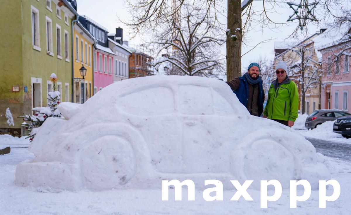 Neighbors build car from snow