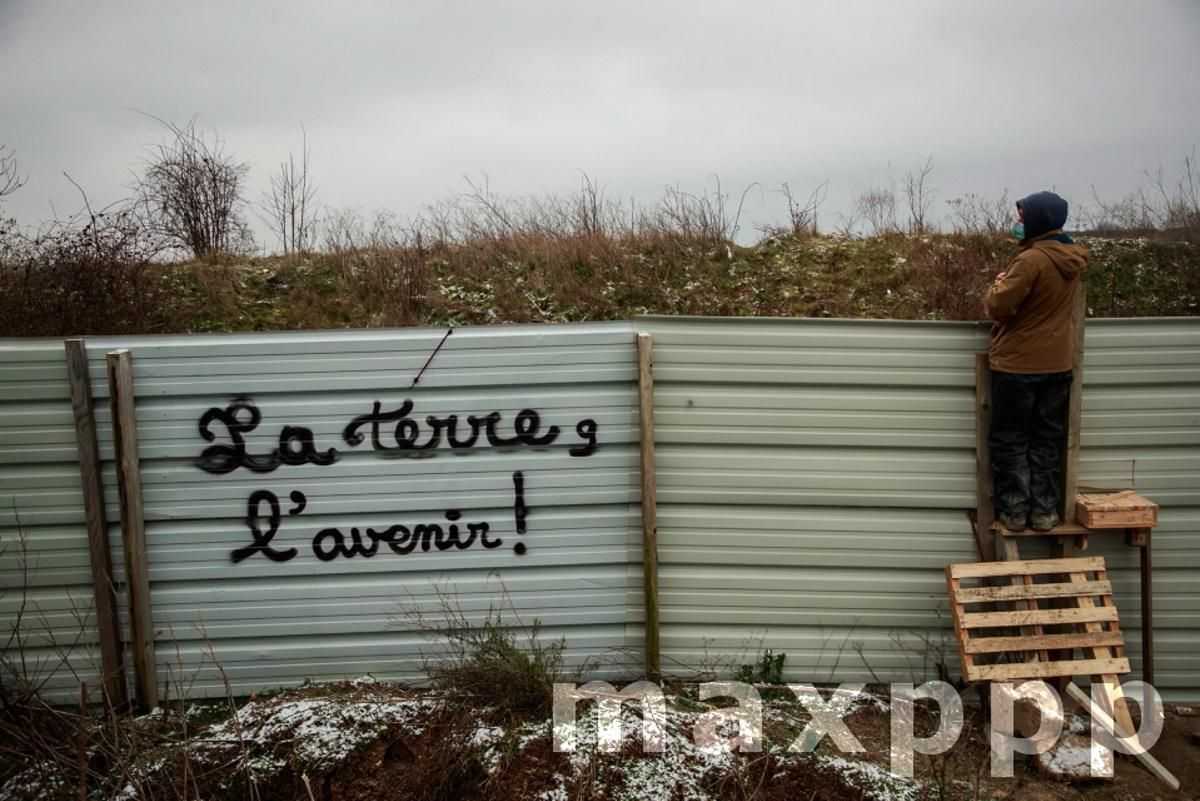 Environmental activists take action to block a Metro station project in Gonesse