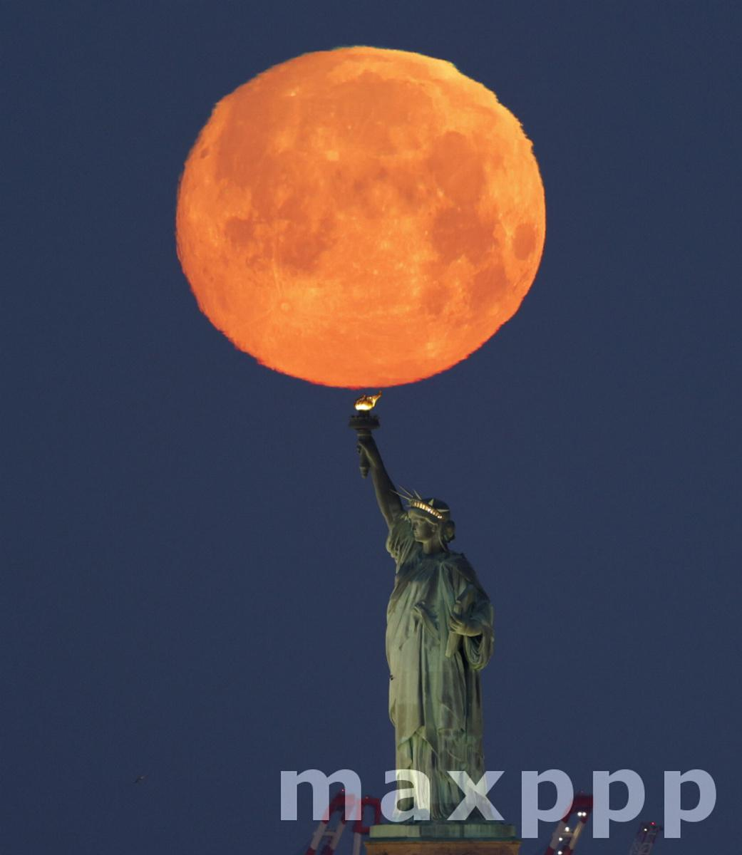 Pink Moon Over the Statue Of Liberty in New York