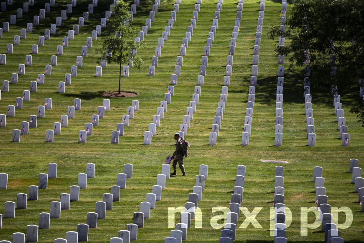 Soldiers place flags at Arlington National Cemetery ahead of Memorial Day