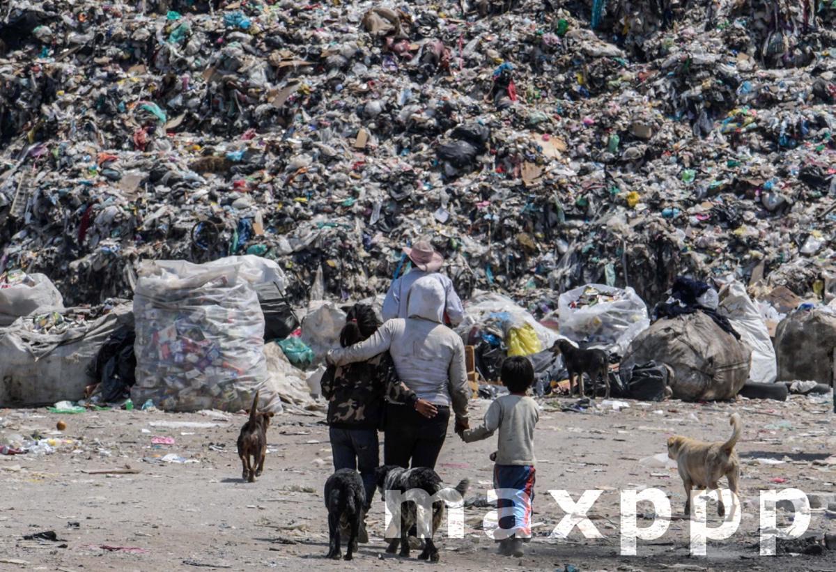 People Collect Waste At The Bordo De Xochiaca Garbage Dump