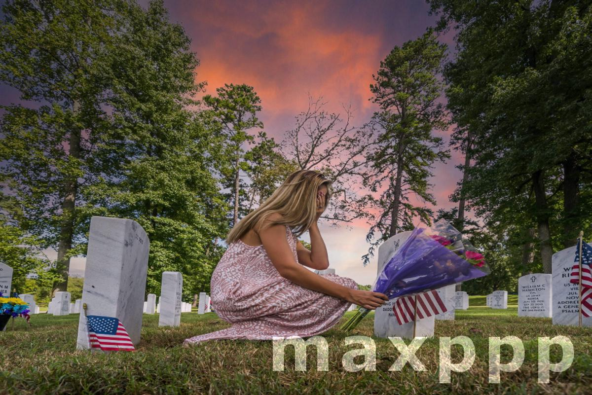 Fallen Family Member At A Military Cemetery